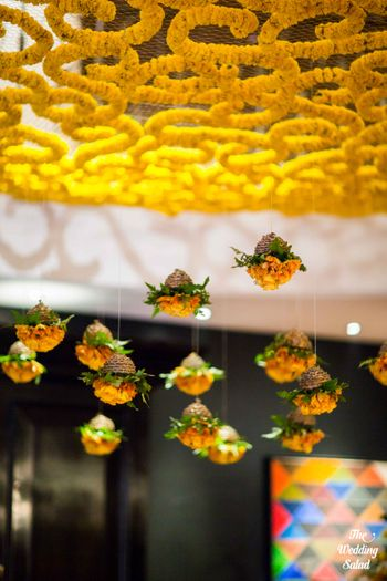 Photo of Floral hanging ceiling arrangements with suspended genda flowers