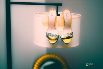 Bridal shoes photography on lamp