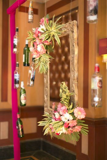 Photobooth with frame and recycled alcohol bottles