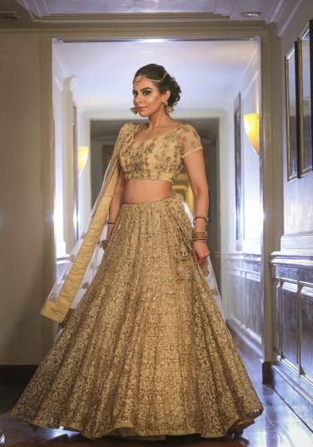 Gold net lehenga for engagement with sequin work