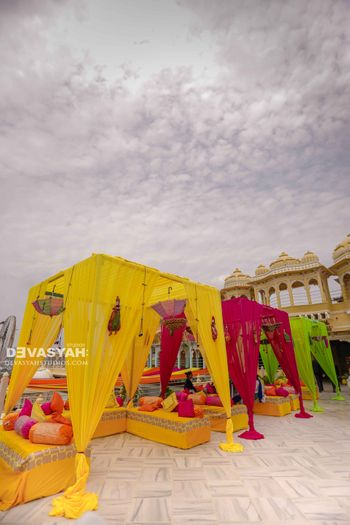Colourful canopies for seating at destination wedding