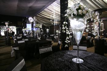 Photo of Tall table centerpieces made out of large cocktail glasses