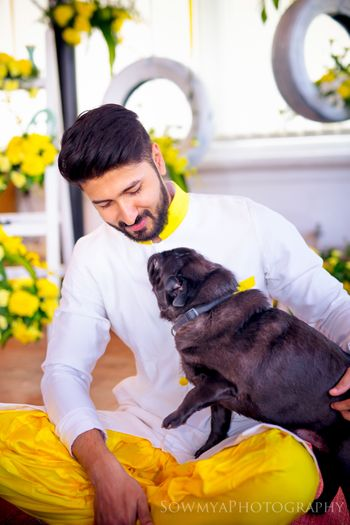 Photo of groom with dog candid shot
