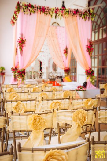 Light pink and yellow mandap and seating