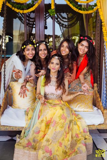 Bride and bridesmaids on mehendi with wreaths