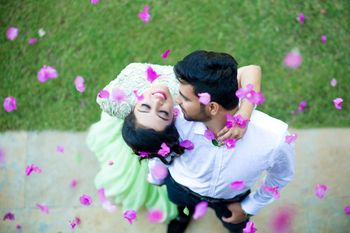 Couple portrait with falling flower petals