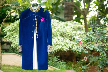 Royal blue velvet sherwani on hanger