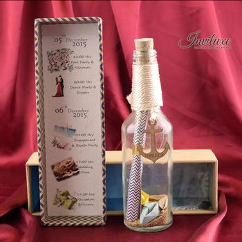 Photo of Nautical theme invite with message in a bottle
