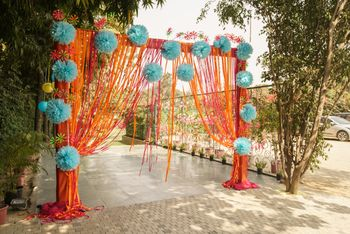 Blue and orange theme entrance decor with floral balls