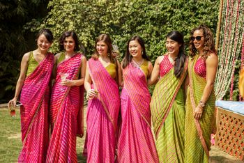 Matching bridesmaids in pink and green sarees