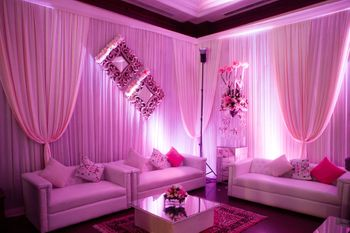 Photo of lavender and white drapes with white and pink cushions