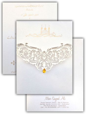Photo of white elegant laser cut invitation cards