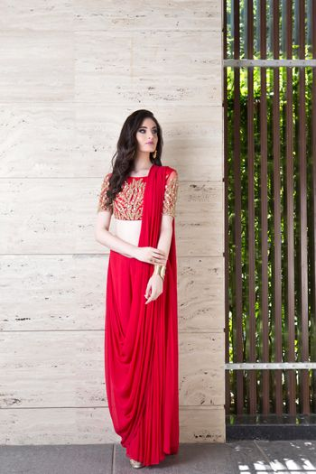 Photo of Bright red saree gown with red and gold blouse