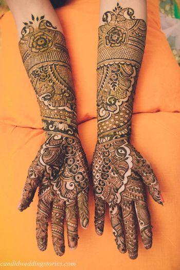 Peacock and buti design bridal mehendi