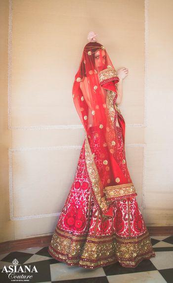 Photo of white and red bridal lehenga