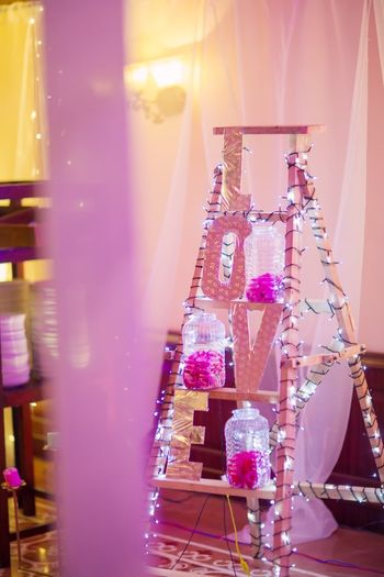 Photo of Corner decor with ladder and love monogram blocks