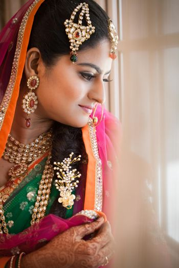 Photo of Bride wearing jhoomer