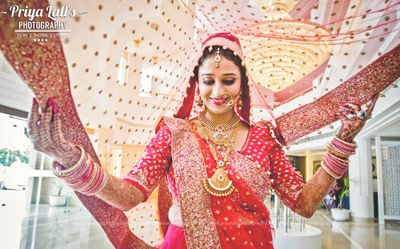 Photo of Bride in Red Lehenga with Layered Necklaces