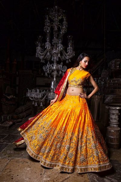 Photo of Bright Orange Light Lehenga with Zardozi Work