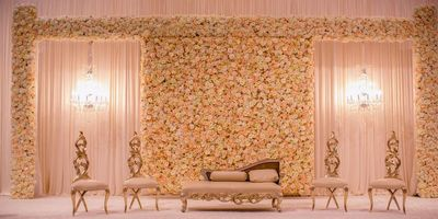 Photo of White flower wall stage backdrop