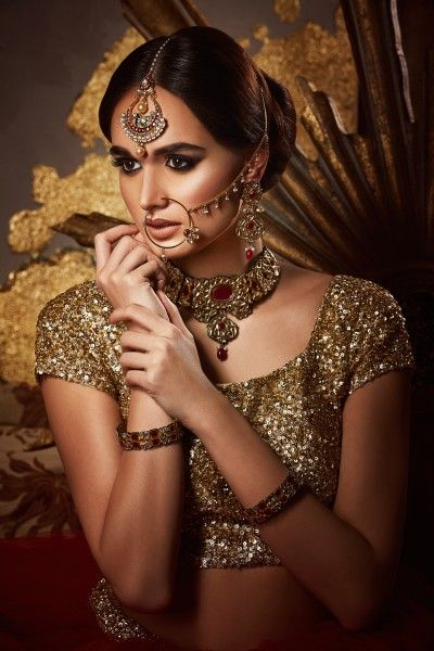 Photo of Gold bridal look with maangtikka and nath