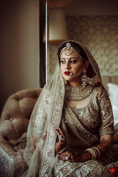 Photo of Bride in offbeat grey bridal lehengas