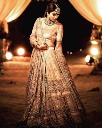 Photo of engagement day gold lehenga