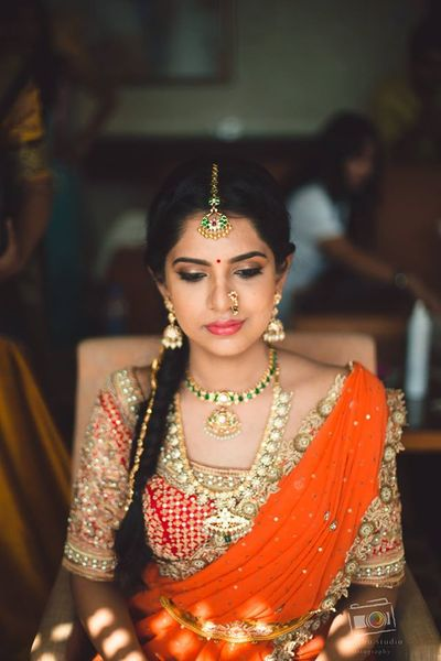 Photo of Orange and red lehenga