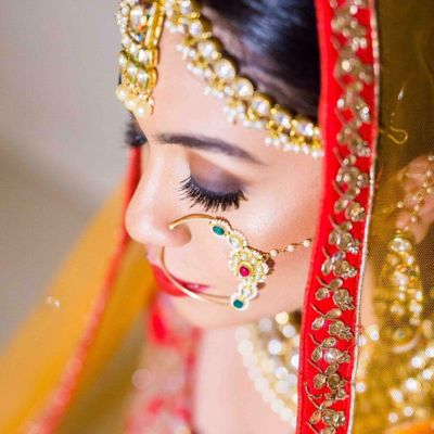 Photo of Big bridal Nath and lehenga with red border