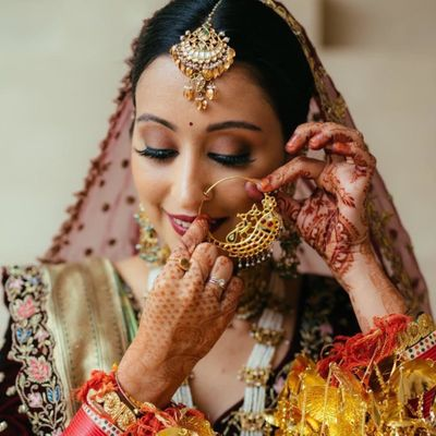 Photo of bride wearing her big nath shot with brown smokey eye