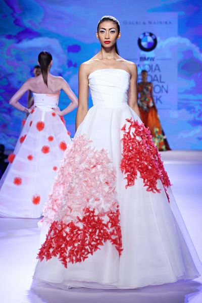 Photo of White and red strapless evening gown