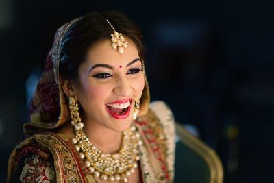 Photo of Happy bride wearing bright red lipstick