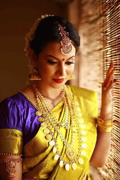 Photo of South Indian bride in yellow and purple saree