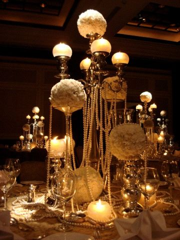 Photo of table centerpiece with candle and candlaabaras