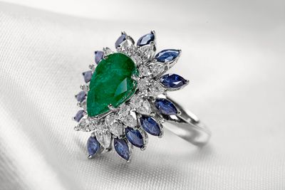Photo of emerald and sapphire cocktail ring with diamonds