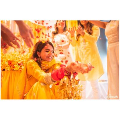 Photo of A bride caught in a happy moment on Haldi ceremony.