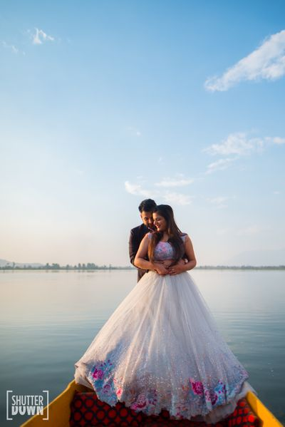 Photo of Pre wedding shoot outfit in gown on boat