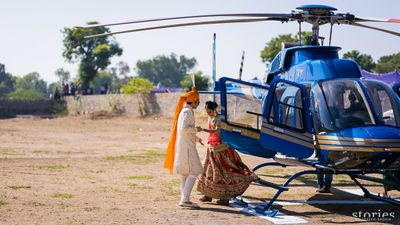 Photo of Bride and groom entering in chopper