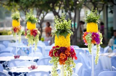 Photo of Summer wedding idea with pineapple shaped floral centerpiece