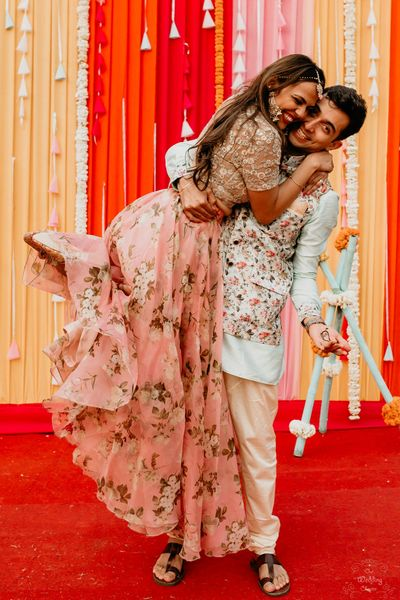 Photo of A cute shot of the couple at their pre- wedding function