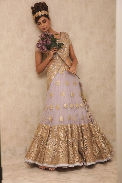 Photo of lavender and gold lehenga with soft pleated lavender net