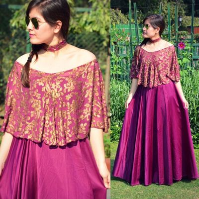Photo of Off-shoulder purple cape lehenga with choker