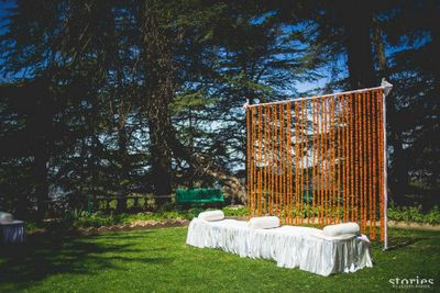 Photo of simple stage decor with genda flower backdrop