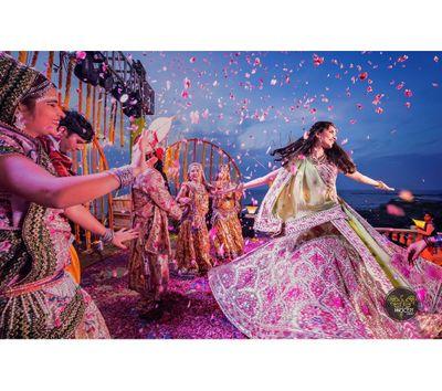 Photo of Dancing bride with petal shower