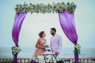 Photo of Couple portrait in destination wedding with purple drape backrop