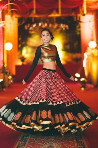 Photo of metallic gold lehenga full sleeves with printed banarsi lehenga skirt