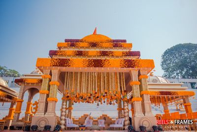 Photo of Pretty orange and red floral decor for mandap