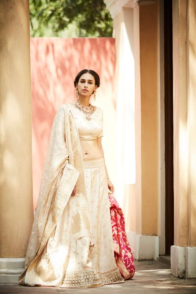 Photo of Simple off white benarasi lehenga