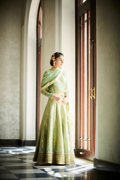 Photo of Light green and gold lehenga for mehendi