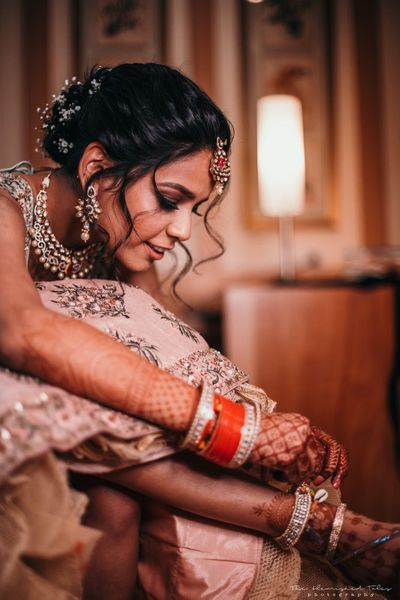 Photo of A bride getting ready for her wedding